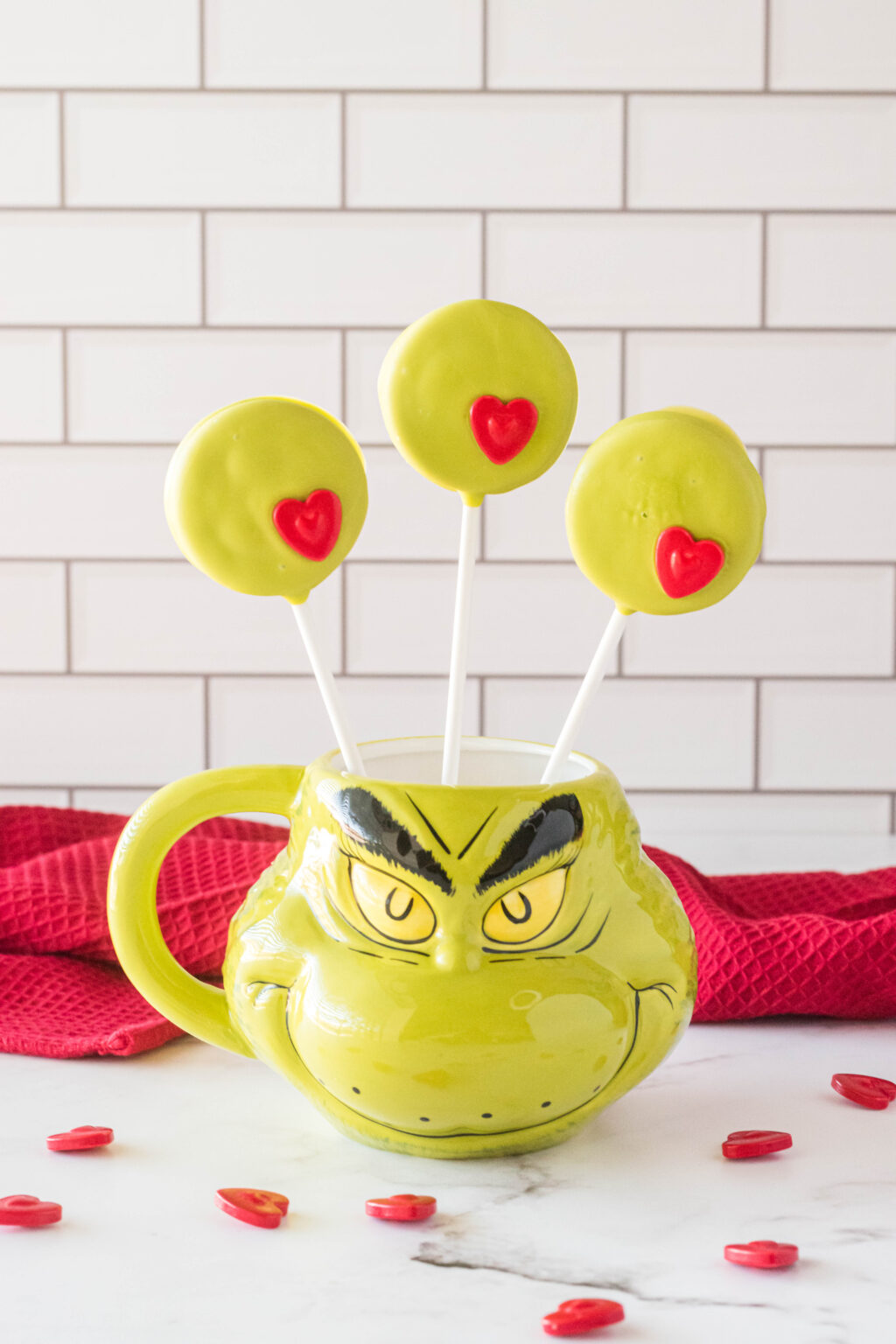 grinch oreo pops in a grinch mug