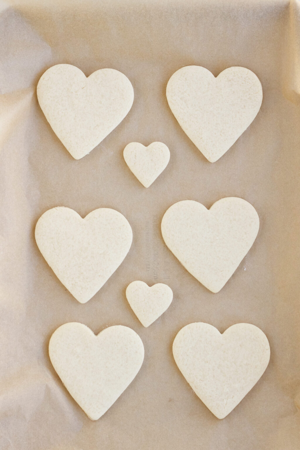 heart cookie dough on a cookie sheet