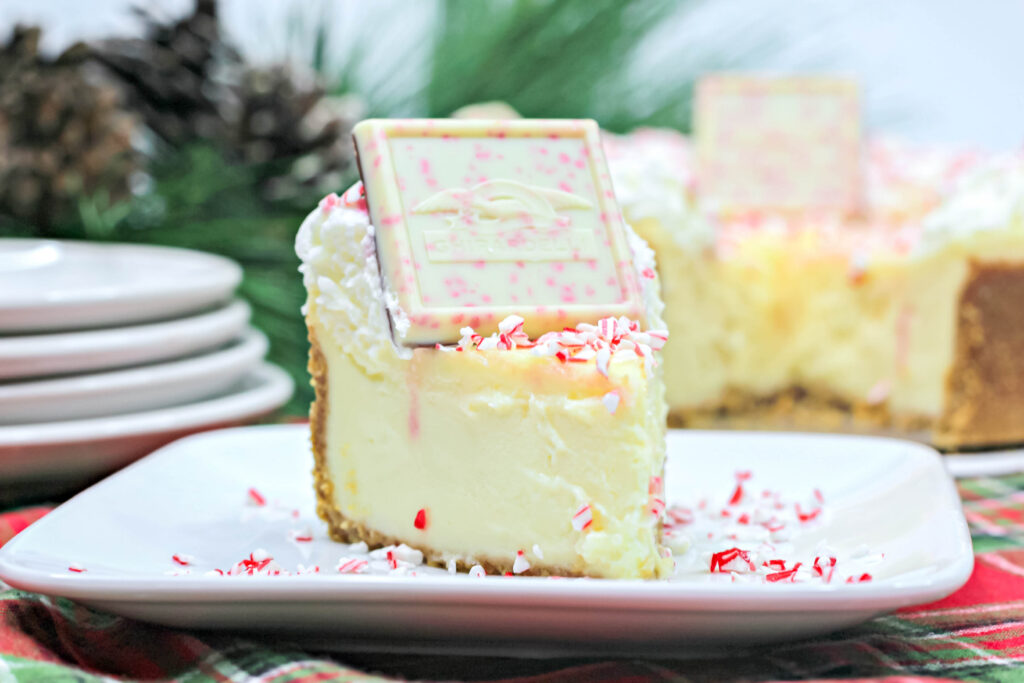 front view of a slice of peppermint cheesecake on a plate