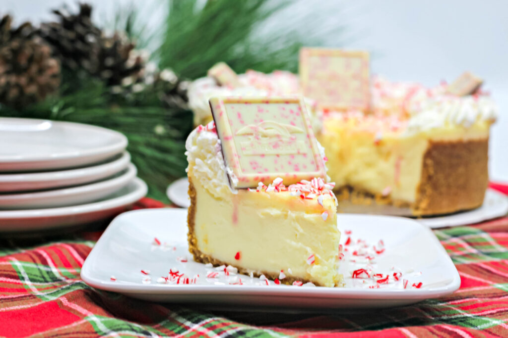 small slice of white chocolate peppermint cheesecake on a plate