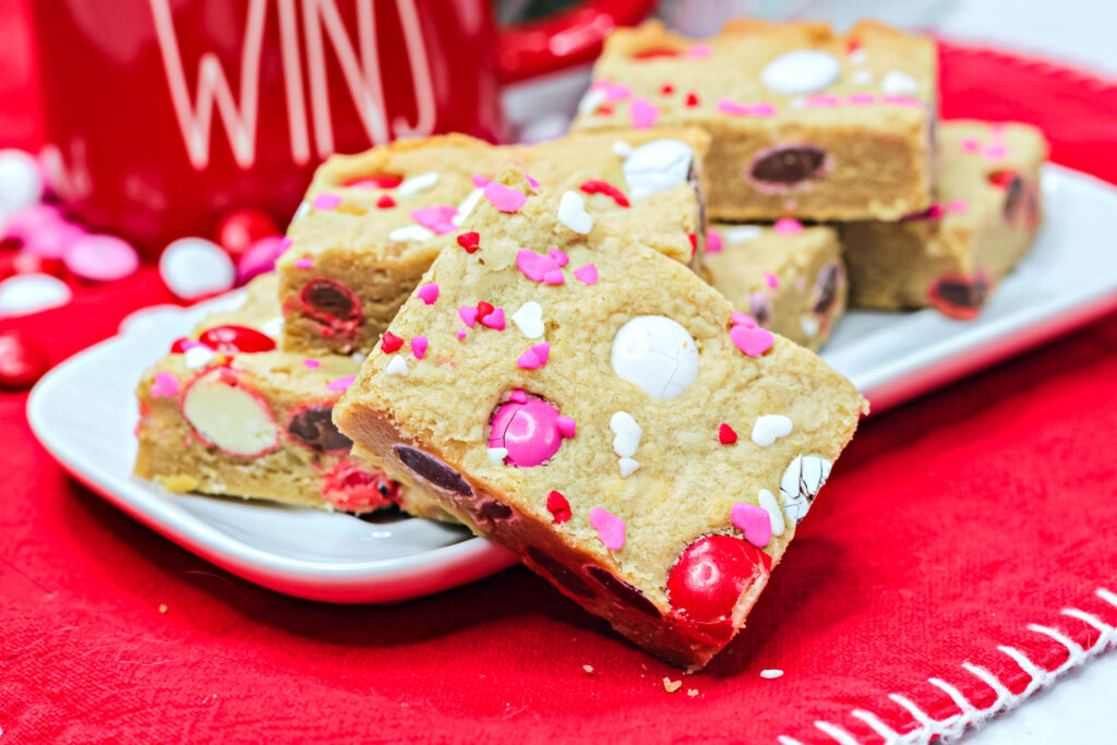 valentine cookie bars stacked on a plate