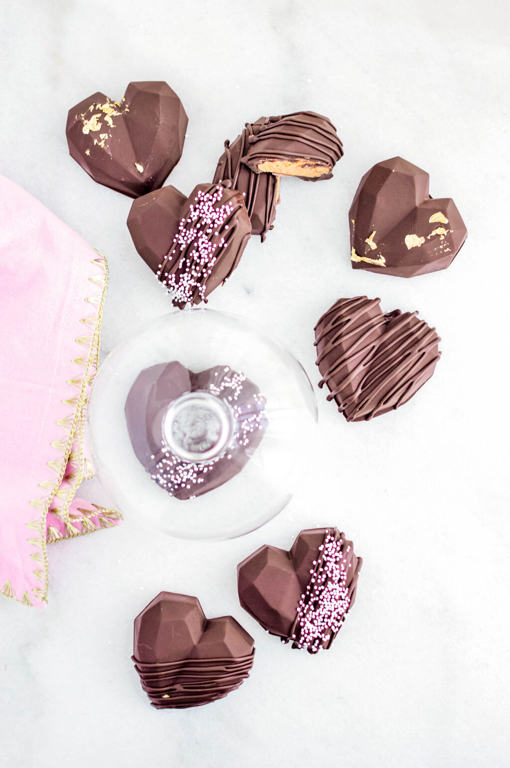 chocolate peanut butter hearts stacked on table