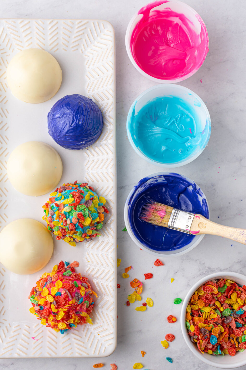 making the fruity pebbles hot cocoa bomb tops