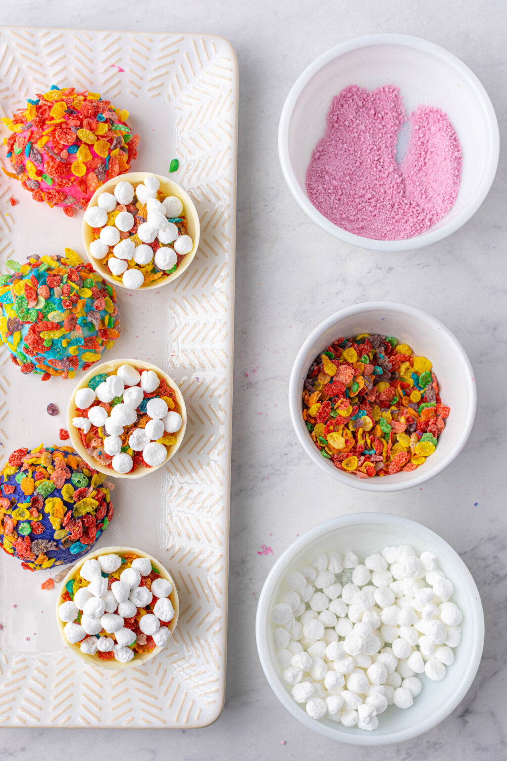 filling the fruity pebbles hot cocoa bombs