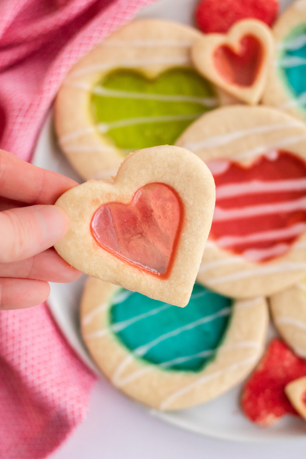 woman holding stained glass cookie