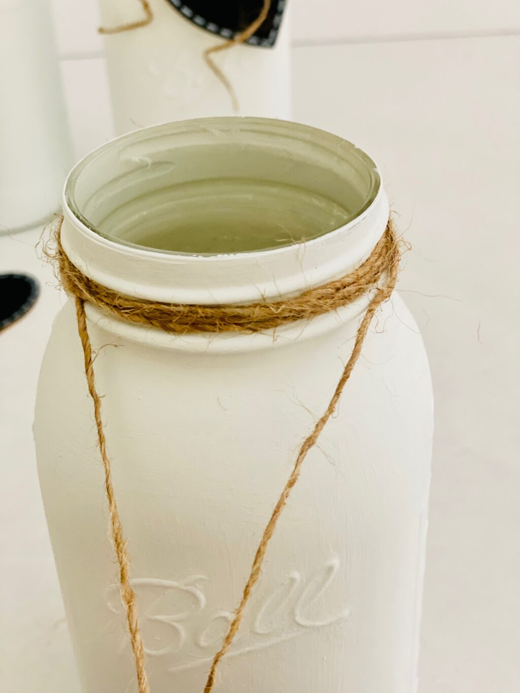 twine wrapped around a mason jar