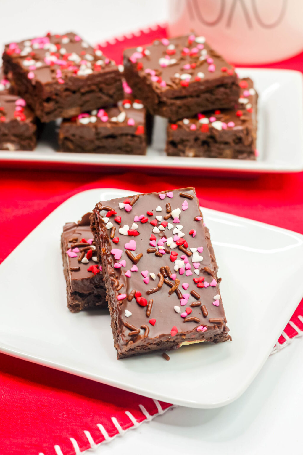 stacked Valentine's Day Brownies on a white plate