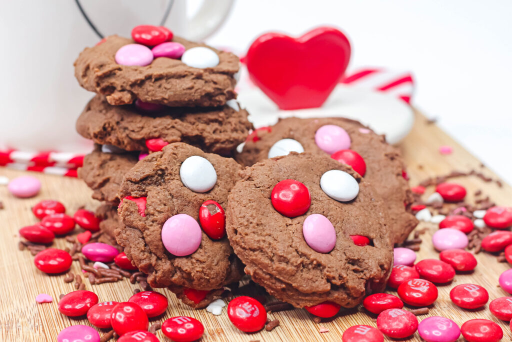 chocolate valentine cookies on a table surrounded by valentine M&Ms