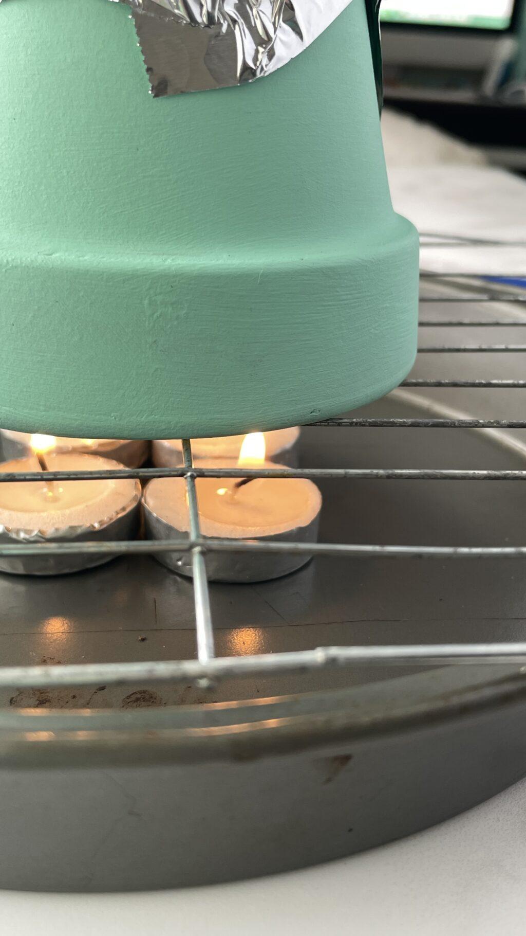 candles inside flower pot heater