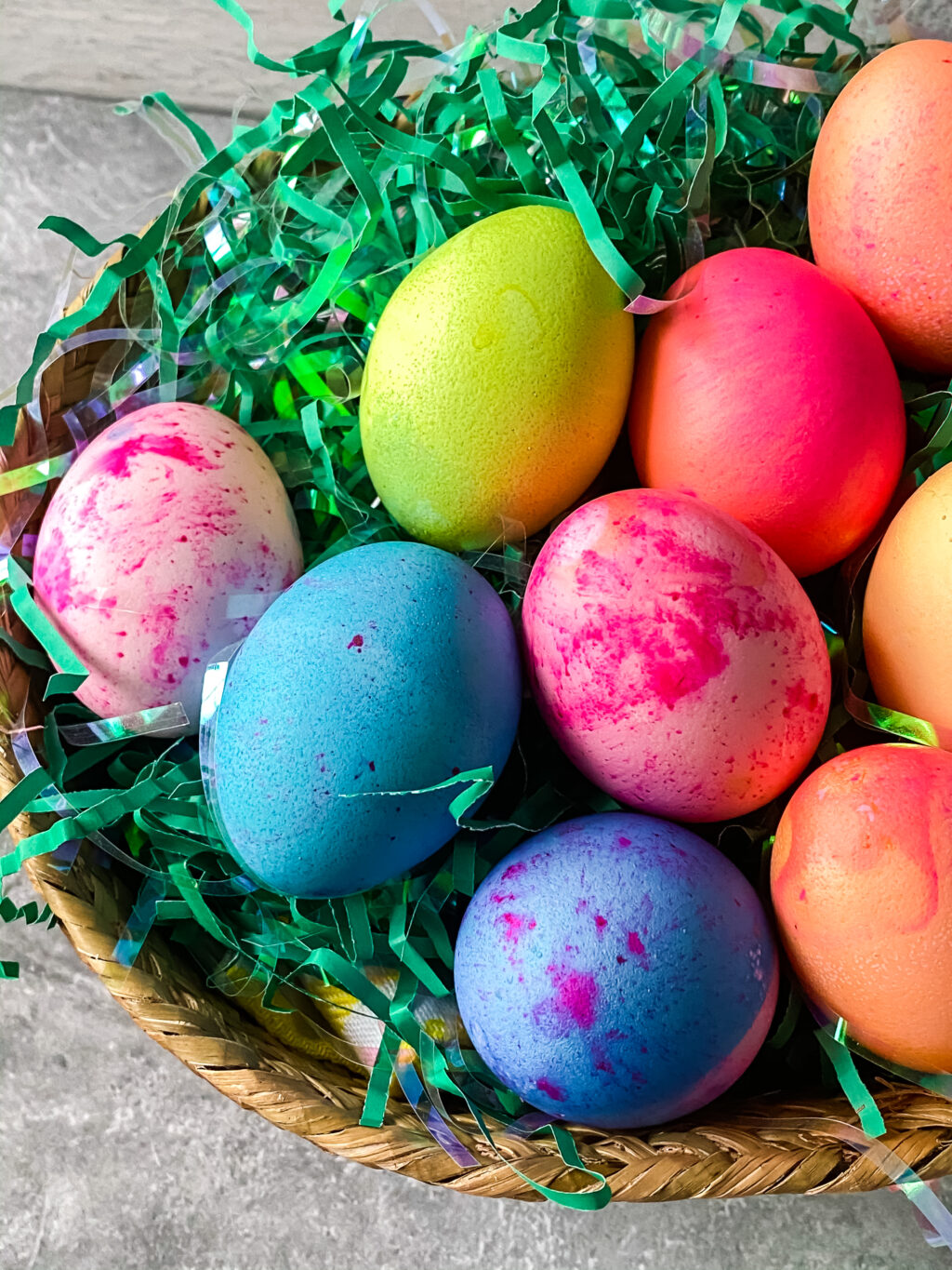 bright colored easter eggs in a basket