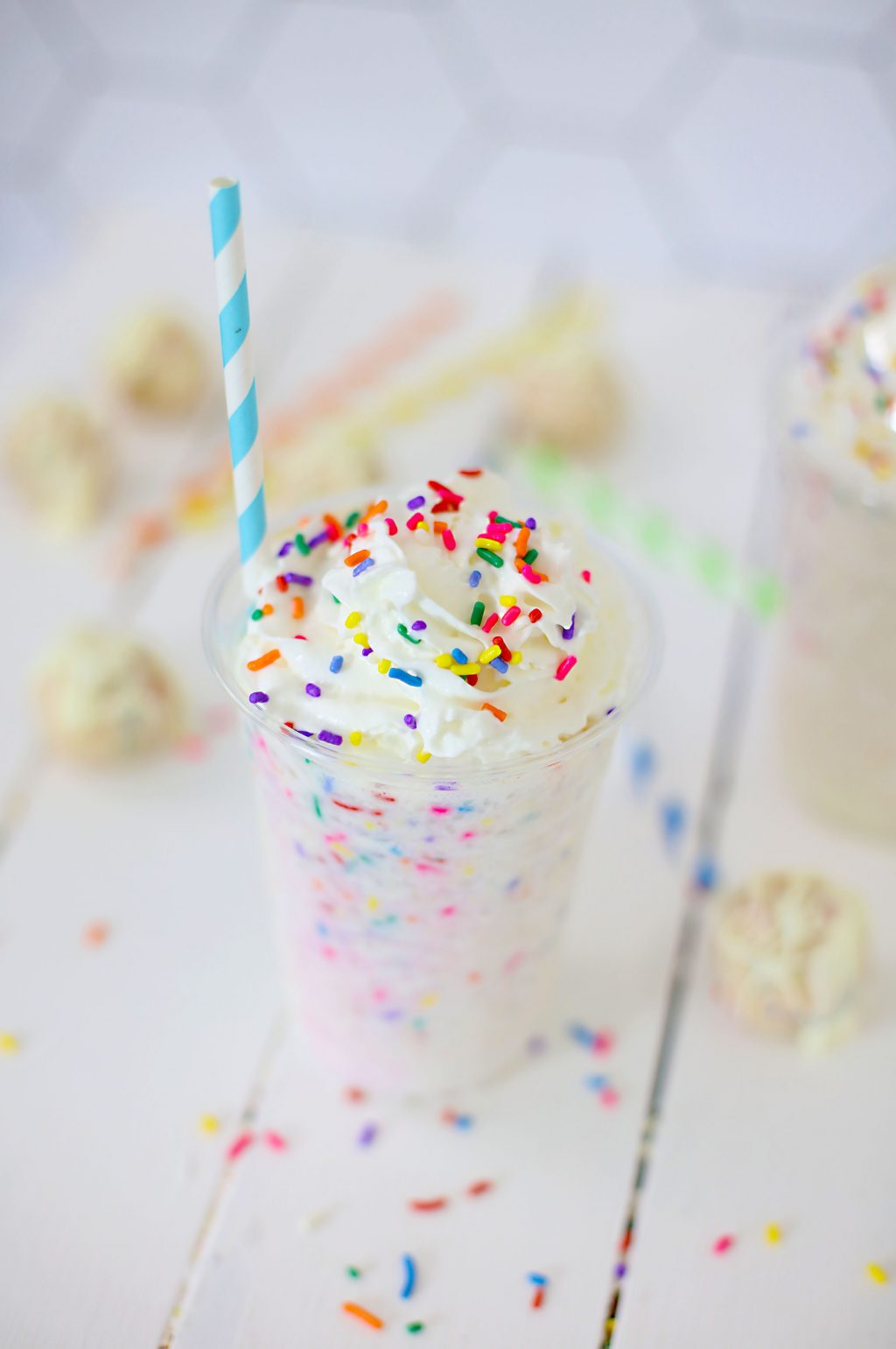 copycat starbucks birthday cake frappuccino in clear cup with straw