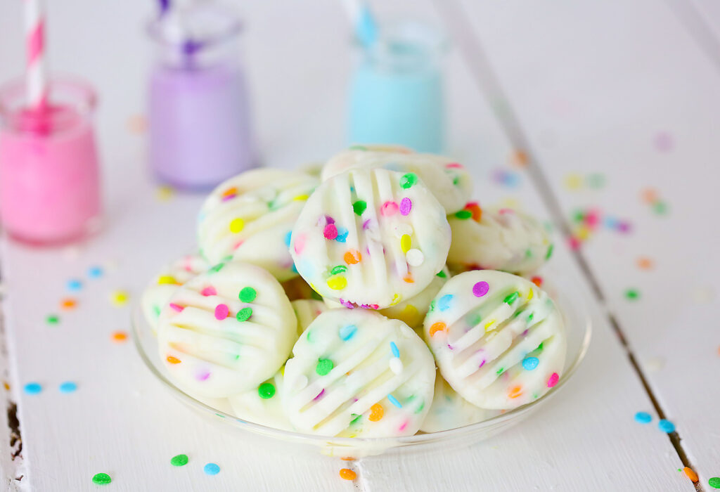 funfetti cream cheese mints on clear plate
