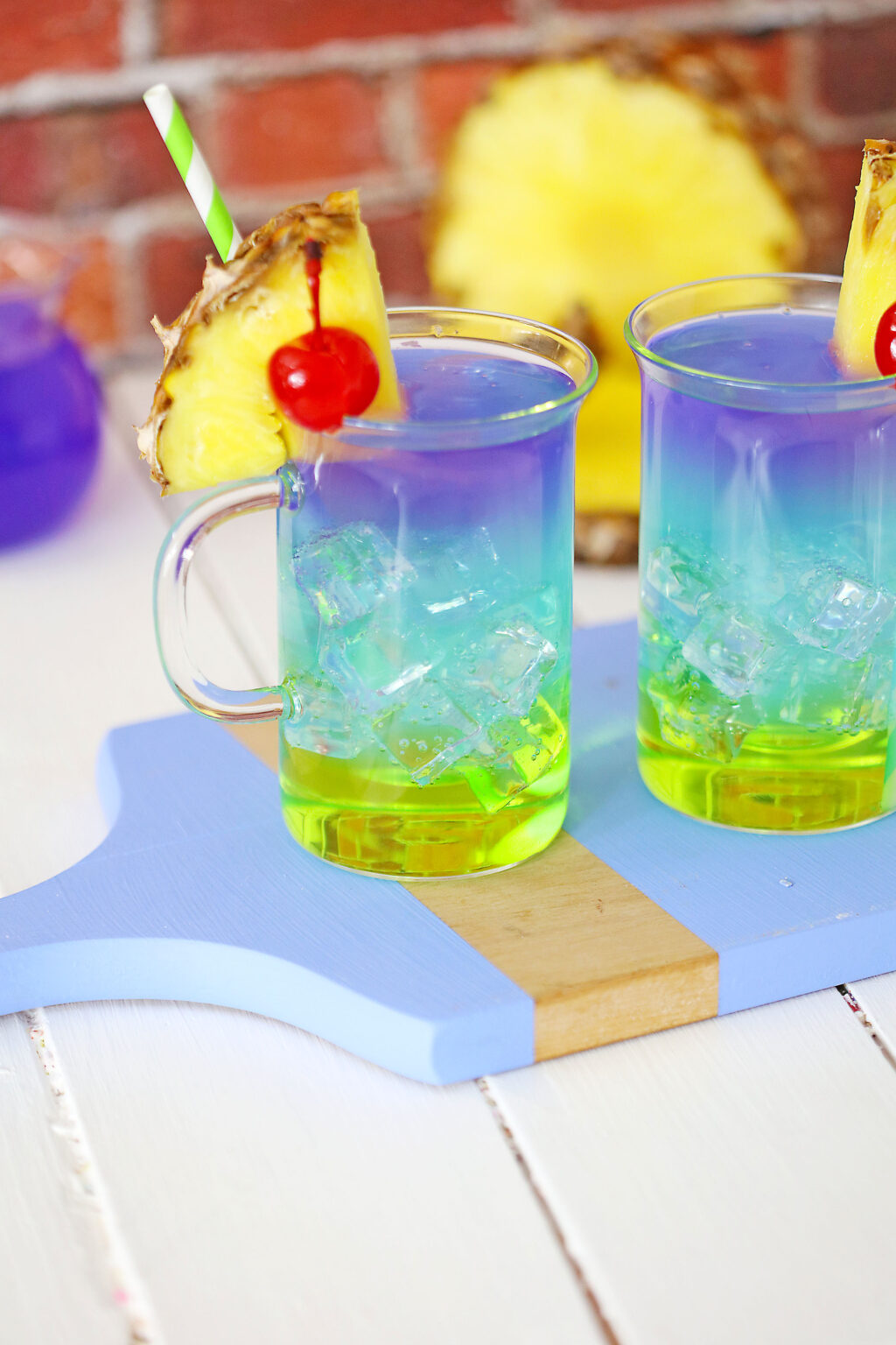 colorful mermaid cocktail in a glass on a cutting board