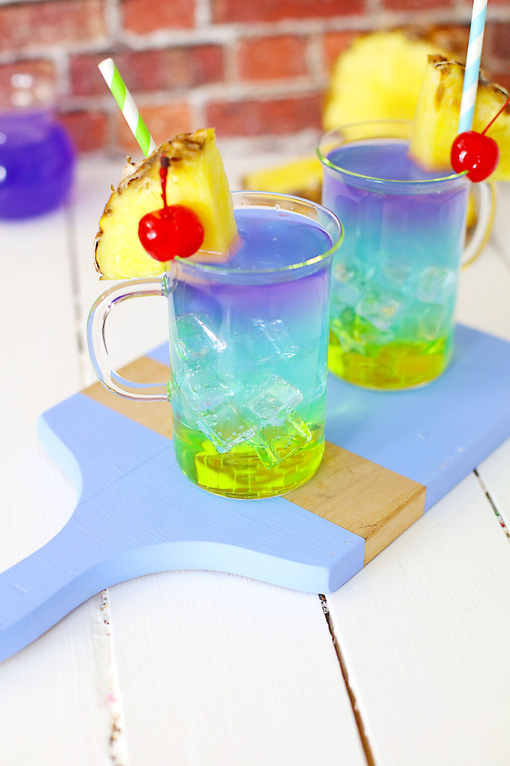 colorful layered mermaid cocktails on a table