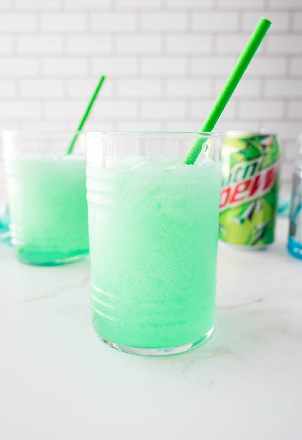 glass filled with homemade mountain dew baja blast freeze