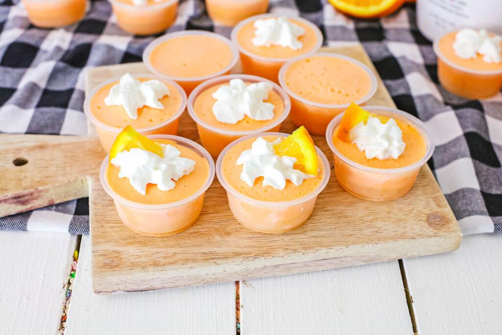 orange creamsicle jello shots on table