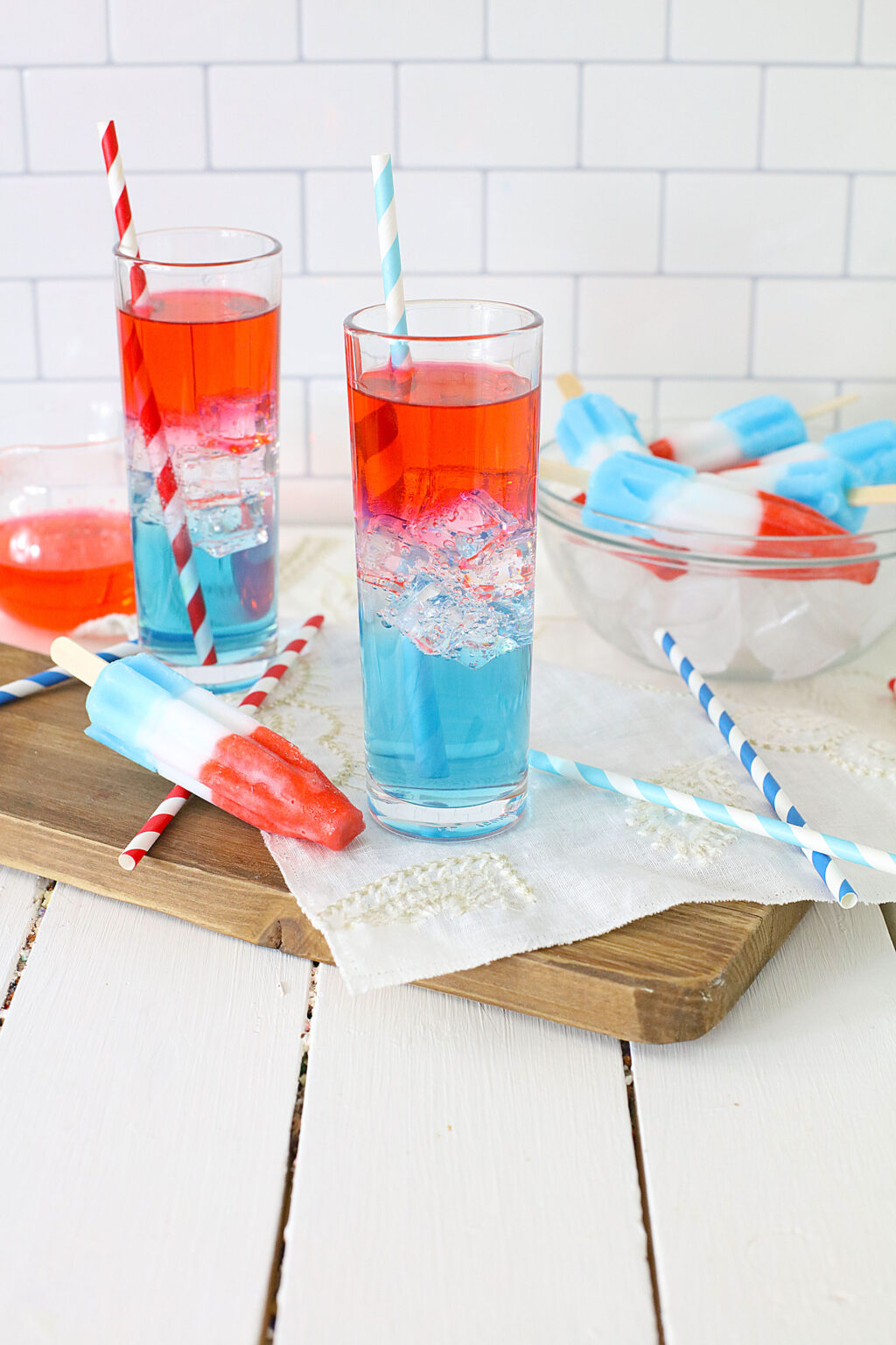 layered bomb pop cocktail in clear glass