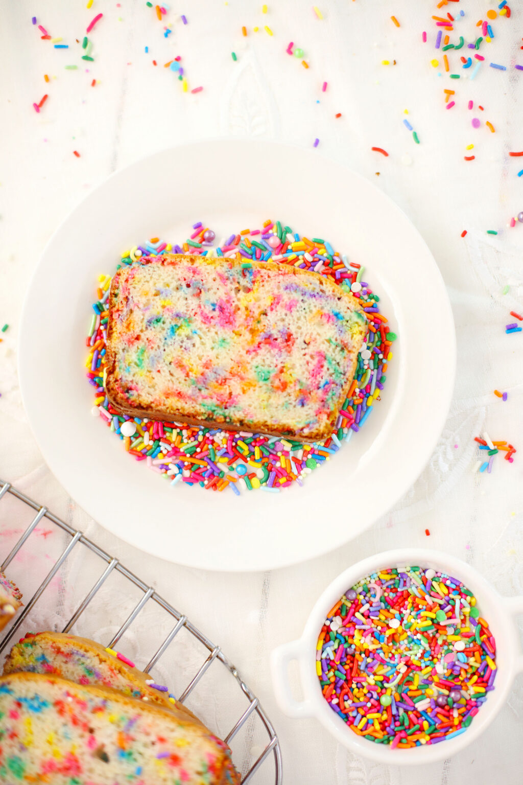 slice of funfetti ice cream bread on a white plate