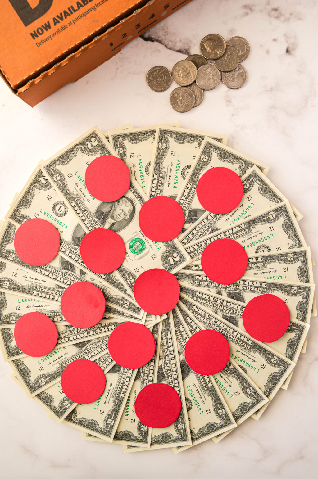 money pizza in pizza box