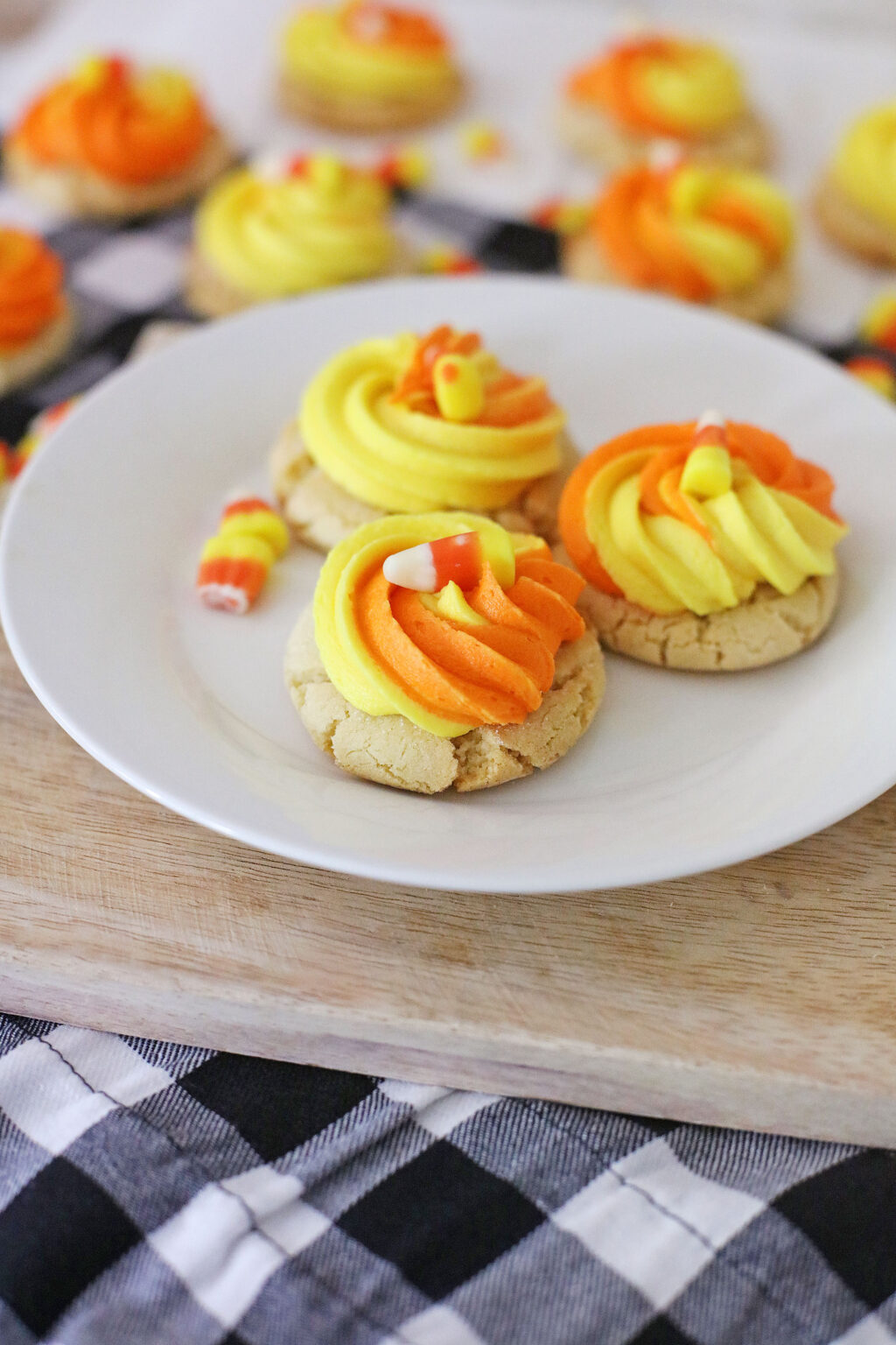 candy corn cookies on a white plate