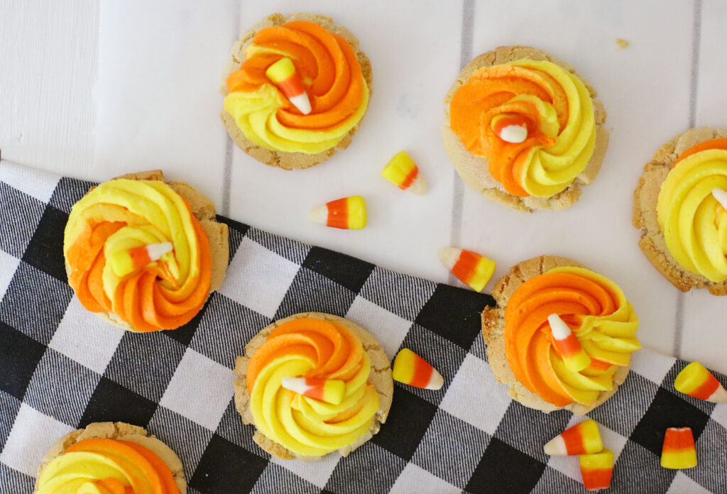 candy corn cookies on a white table