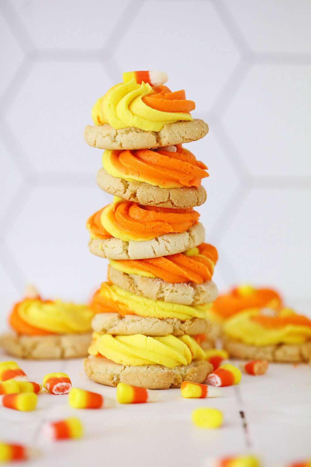 candy corn cookies stacked on top of each other on a white table