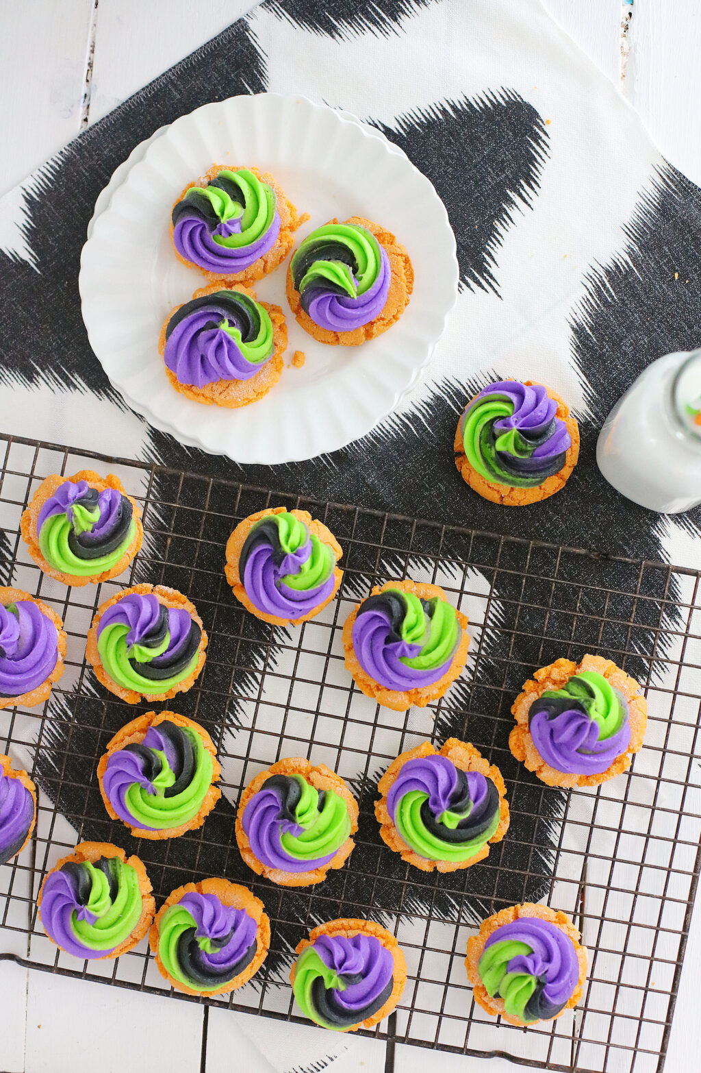 top view of Pumpkin Sugar Cookies With Buttercream Swirl Frosting on a cookie sheet