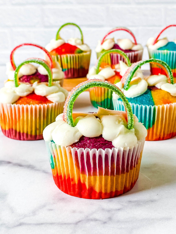 easy rainbow cupcakes on table