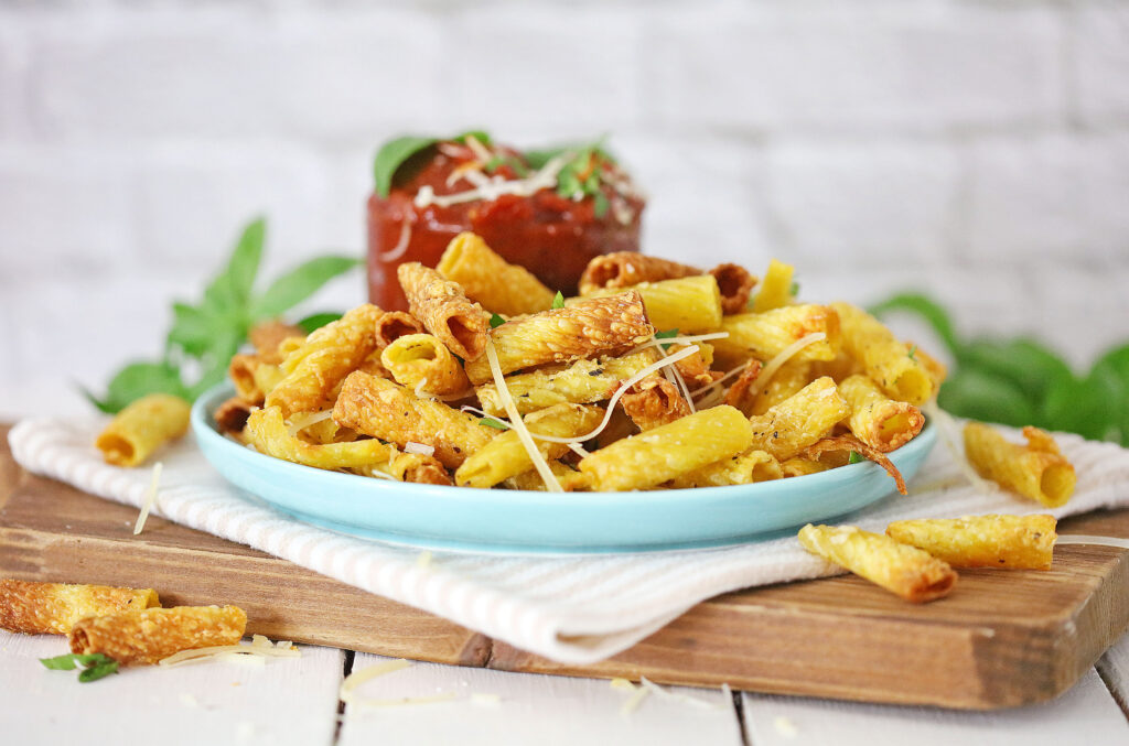 air fryer pasta chips on a blue plate