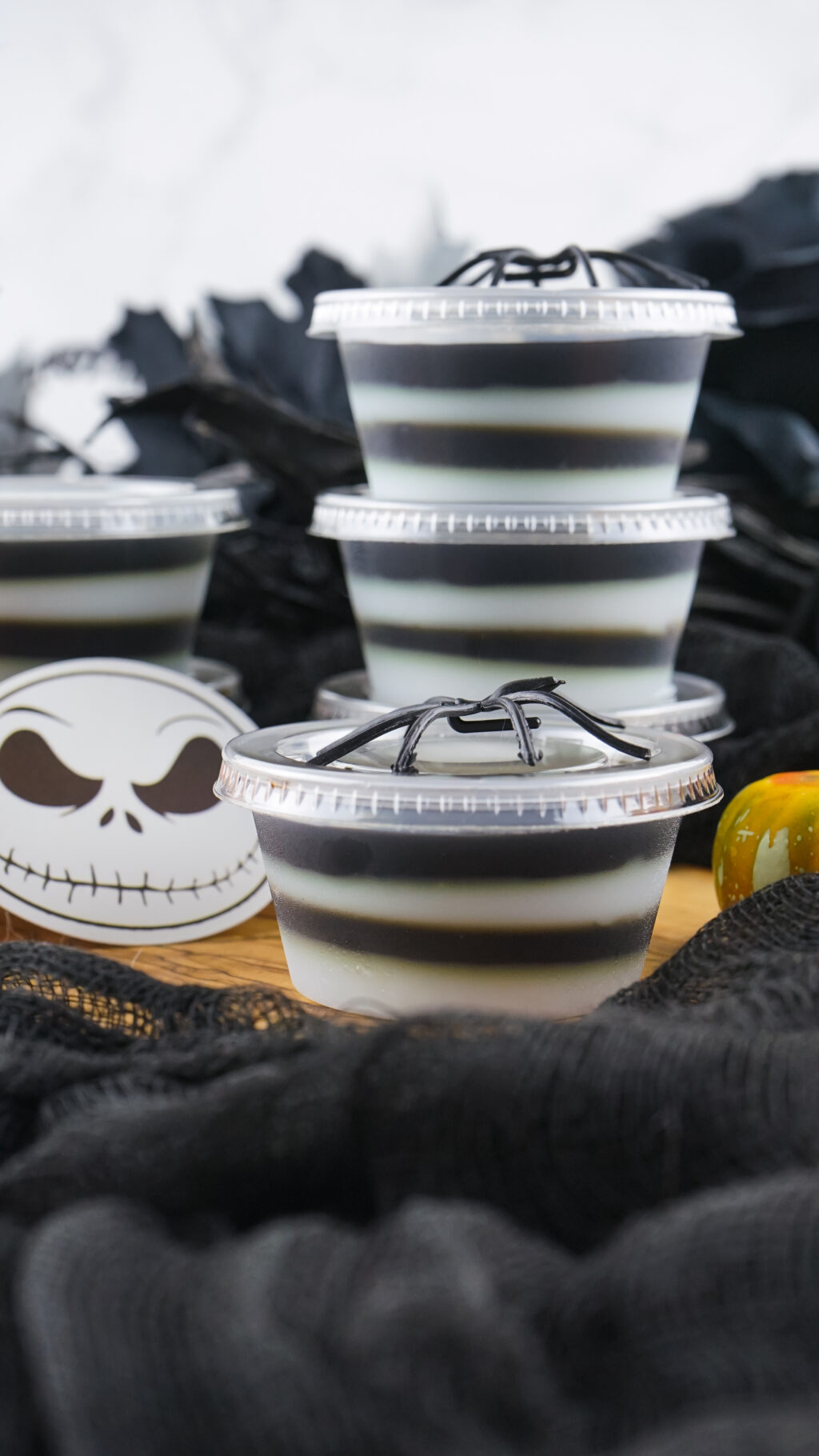 jack skellington jello shots with lids on a table