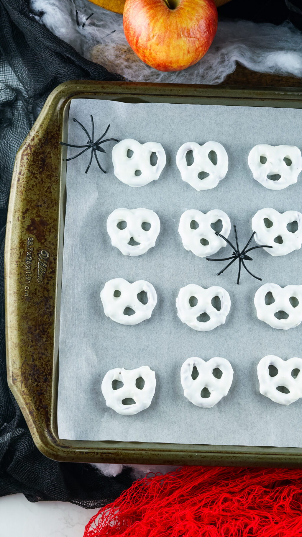 white chocolate pretzels on a baking sheet drying