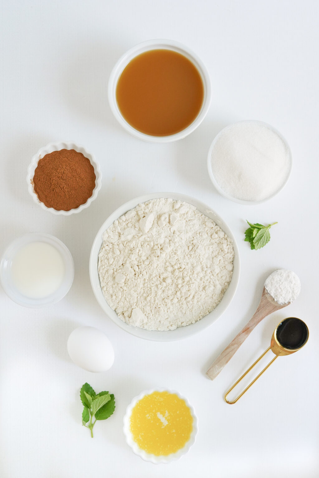 apple cider donut holes ingredients on a white table