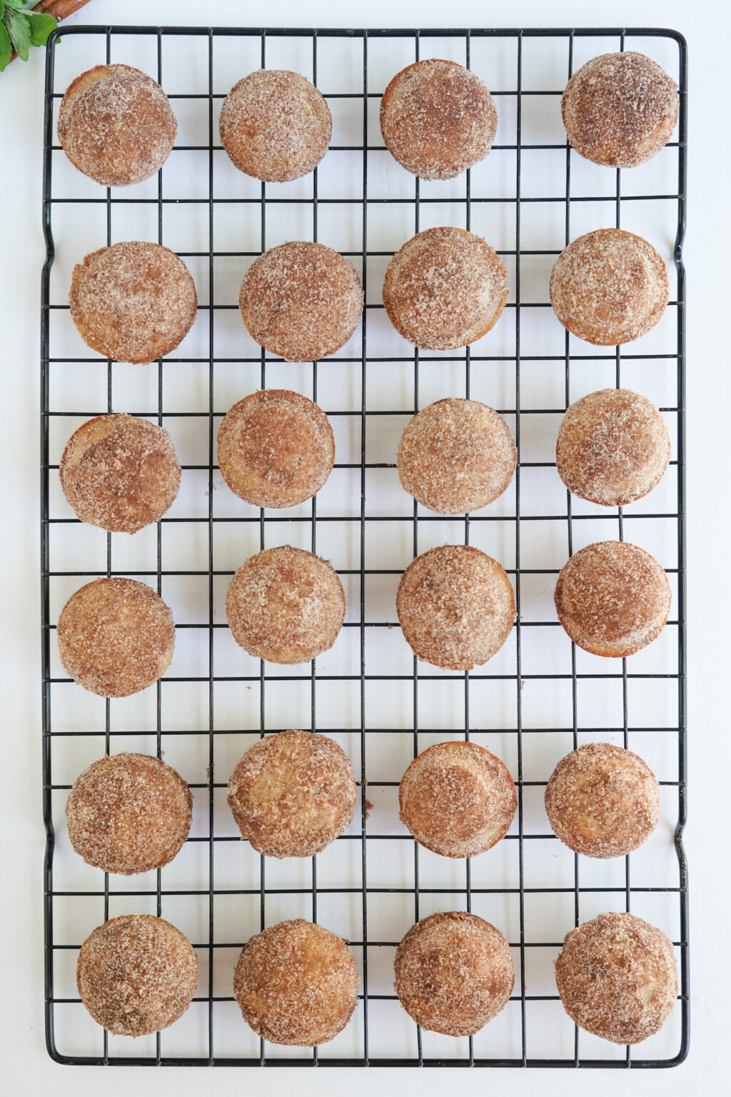 top view of apple cider donut holes on a cooling rack