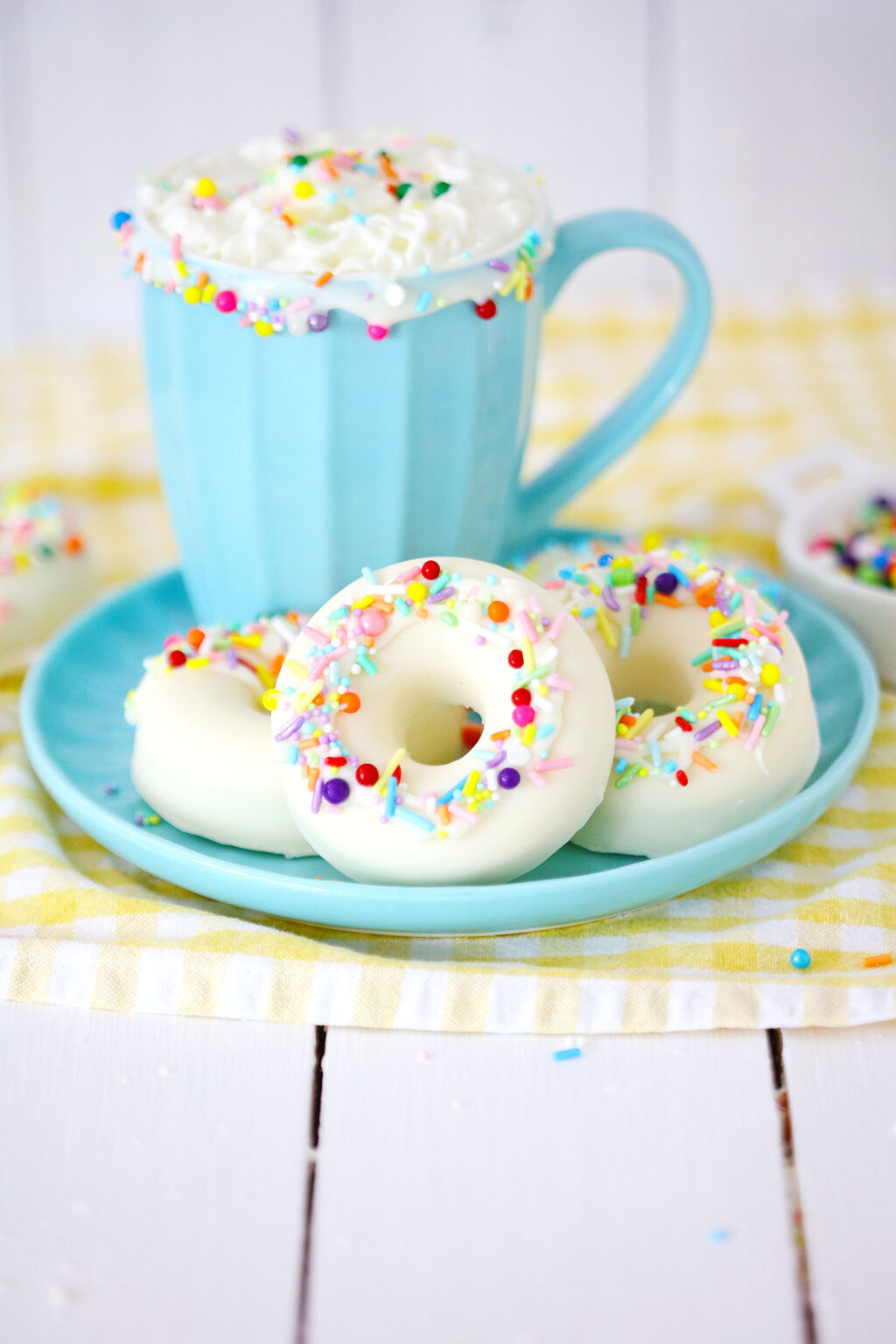 white chocolate donut hot cocoa bombs on blue plate