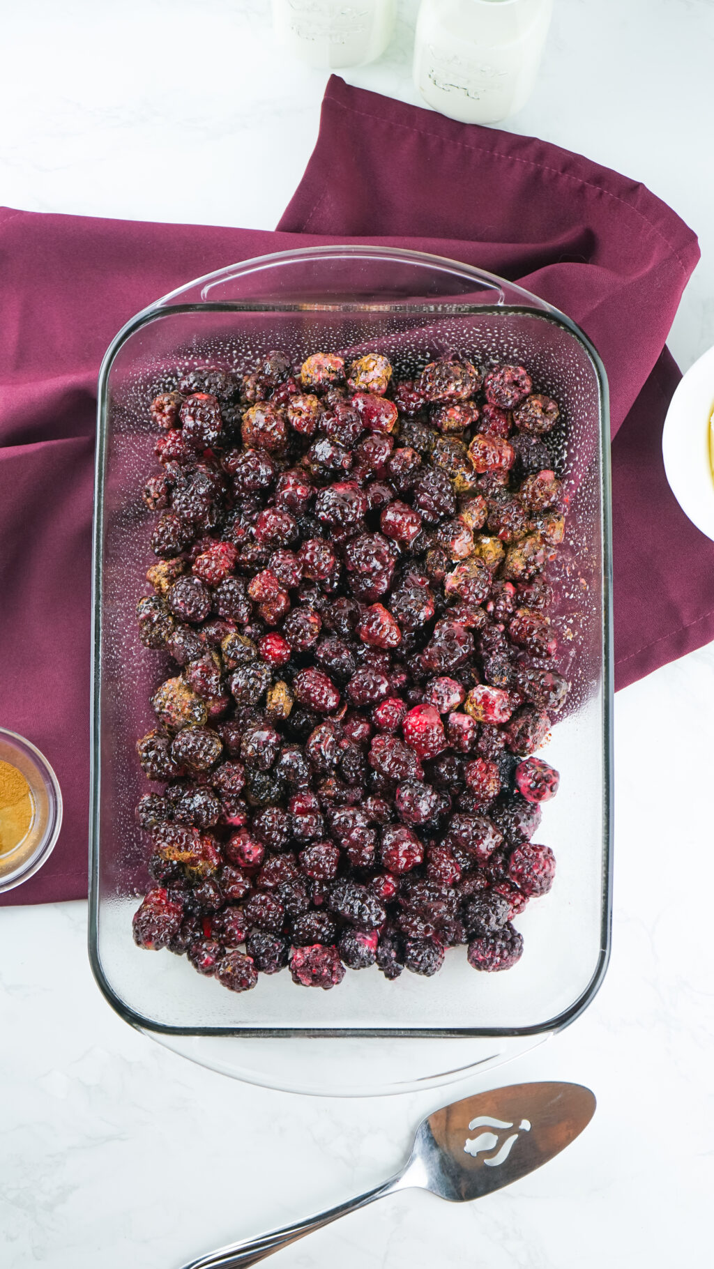 sugar coated blackberries spread out in a baking dish