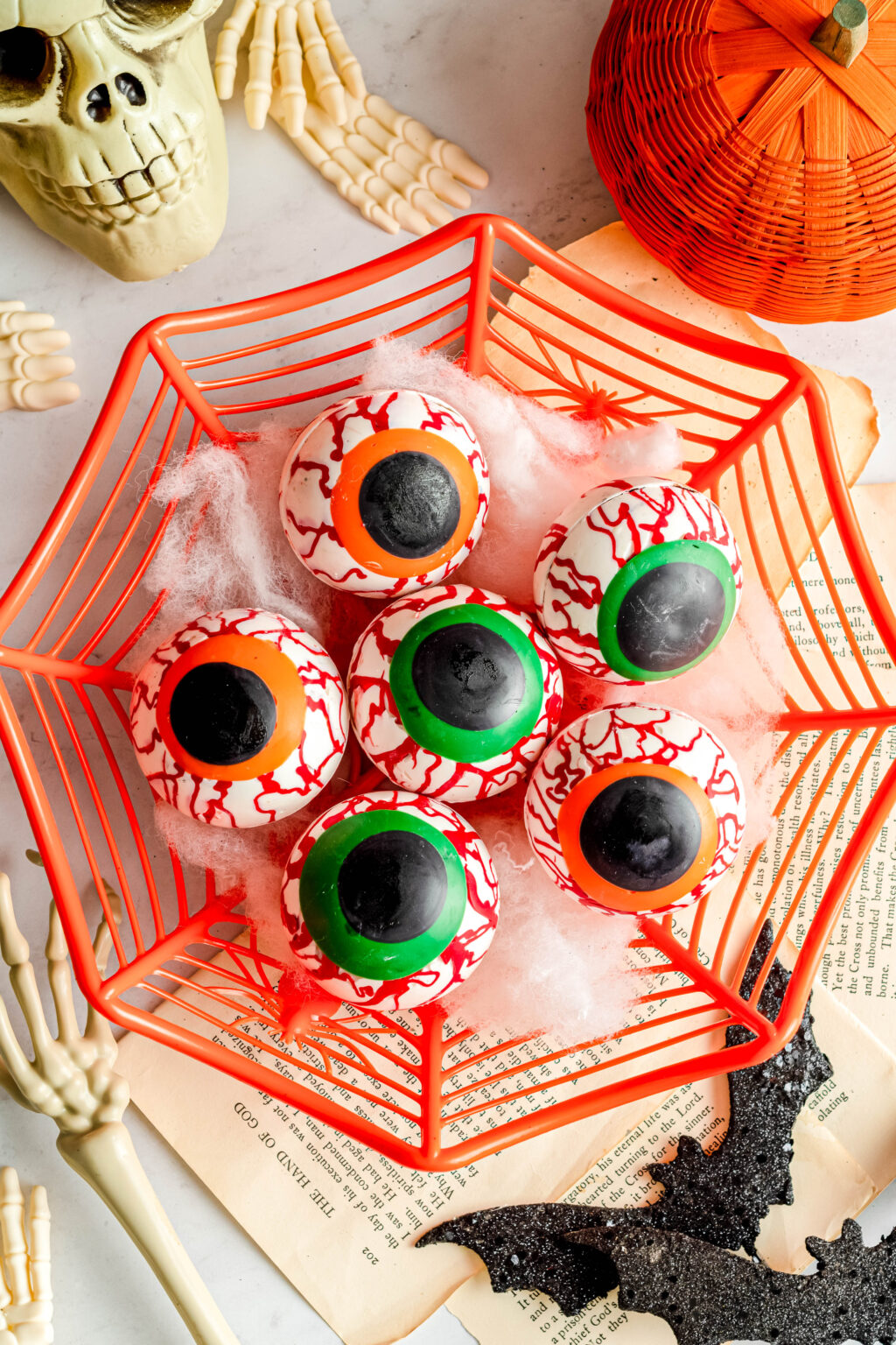 eyeball hot cocoa bombs in an orange container