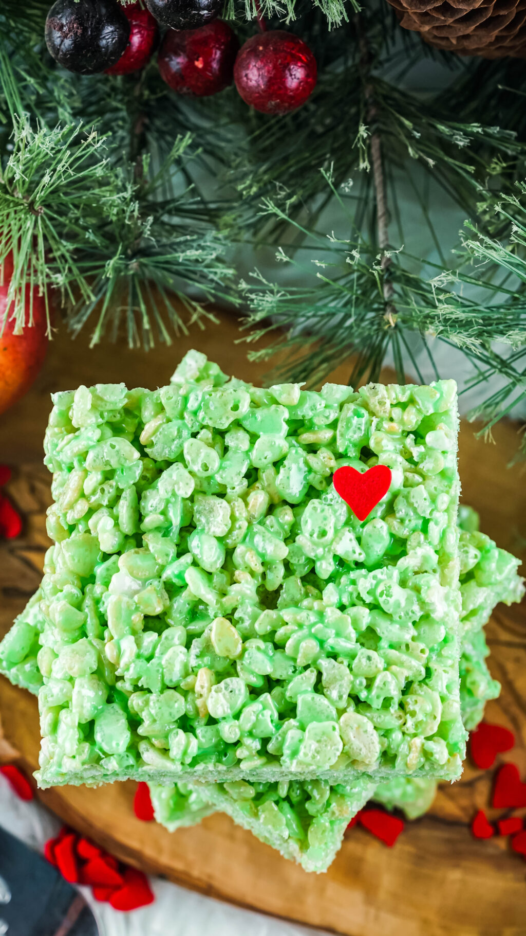 green grinch rice krispies treat stacked on wood plate