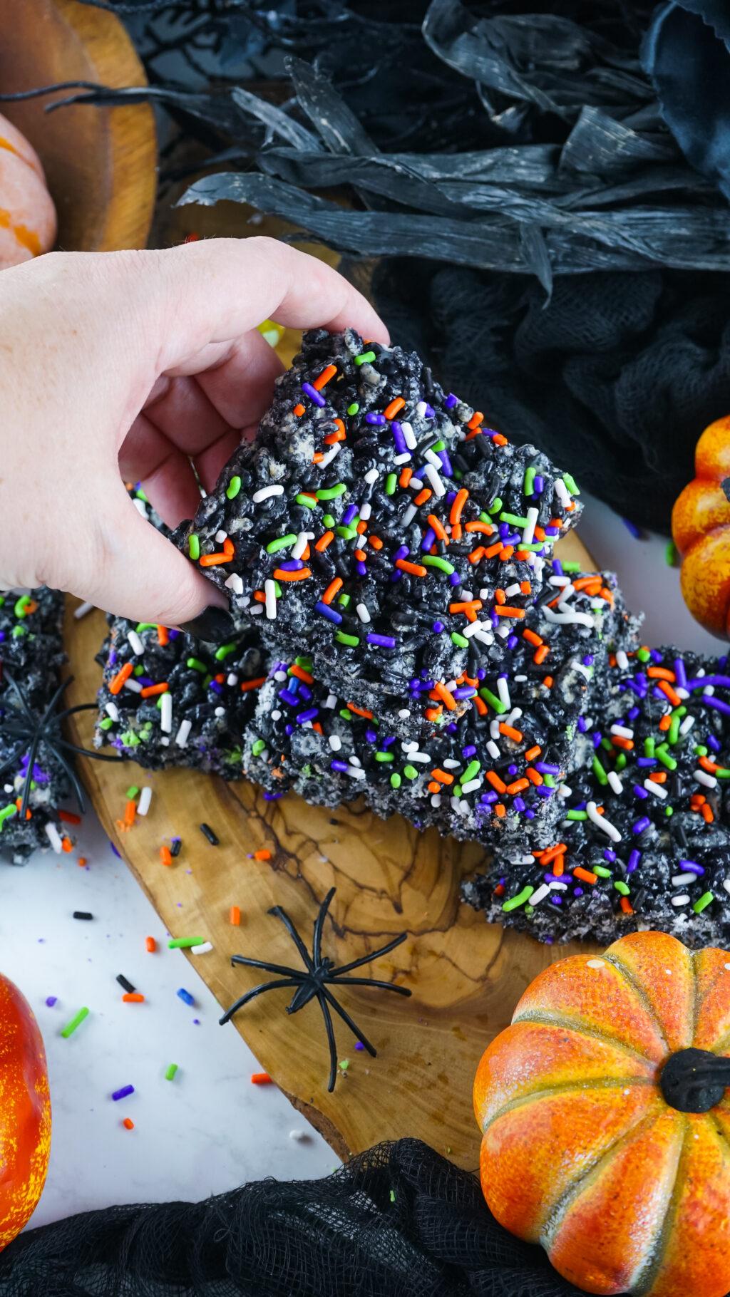 hand holding a halloween rice krispie treat