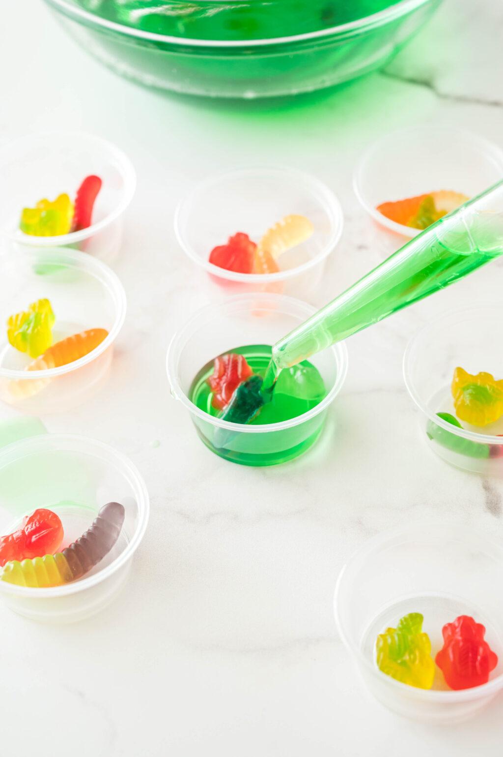 green jello poured into plastic cups