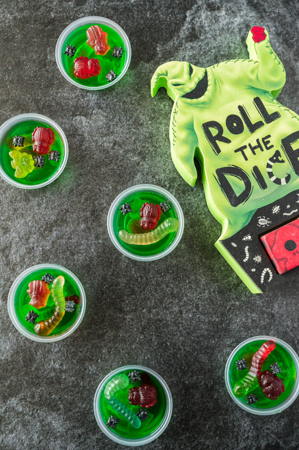 oogie boogie jello shots on a black table