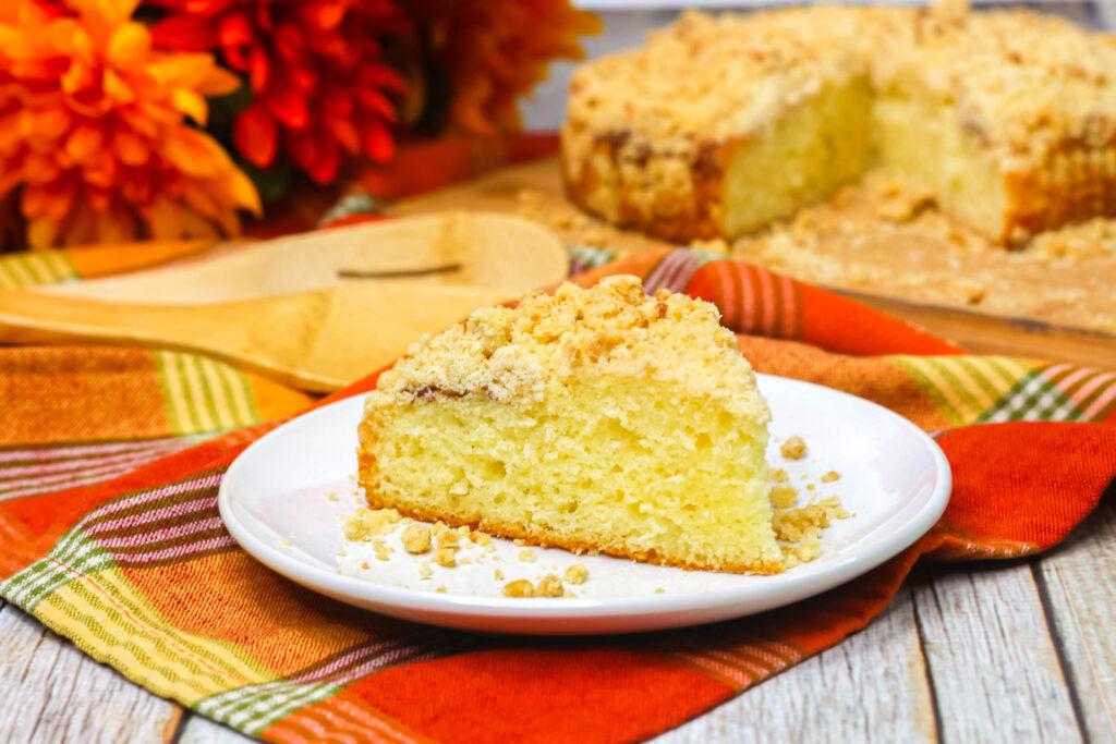 slice of pumpkin spice coffee cake on white plate