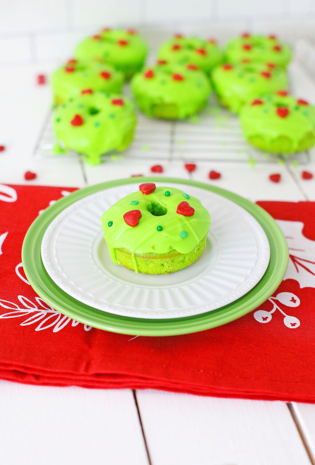 grinch donut decorated on white plate