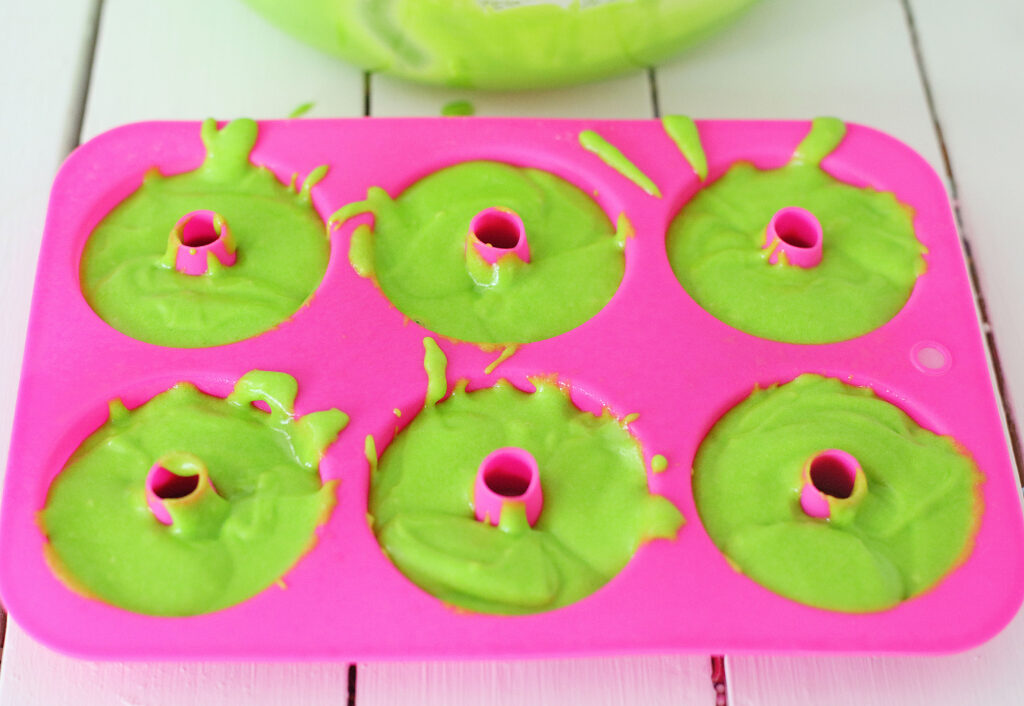 grinch donuts batter in donut pan