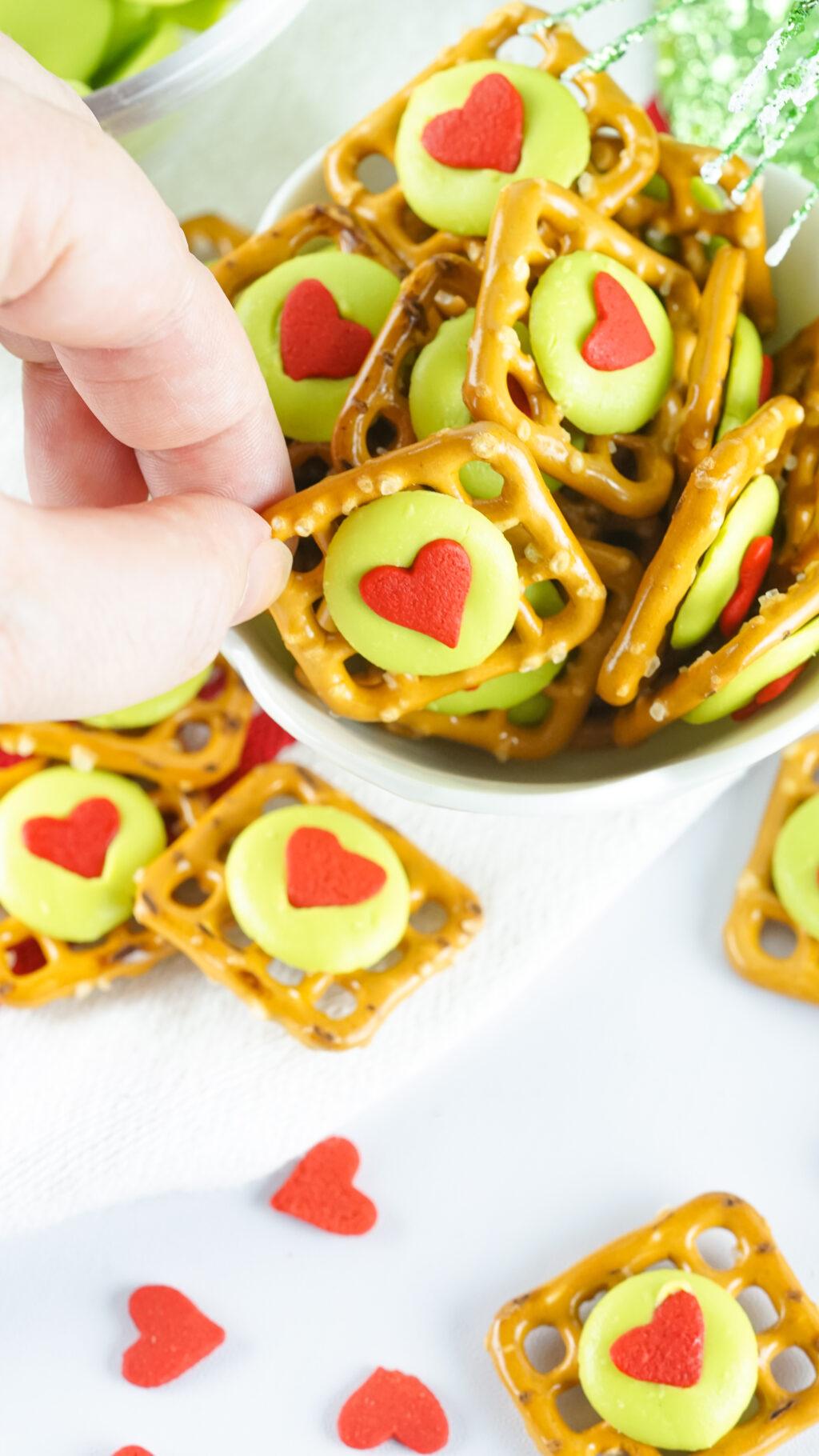 grinch pretzel bites on a cookie sheet