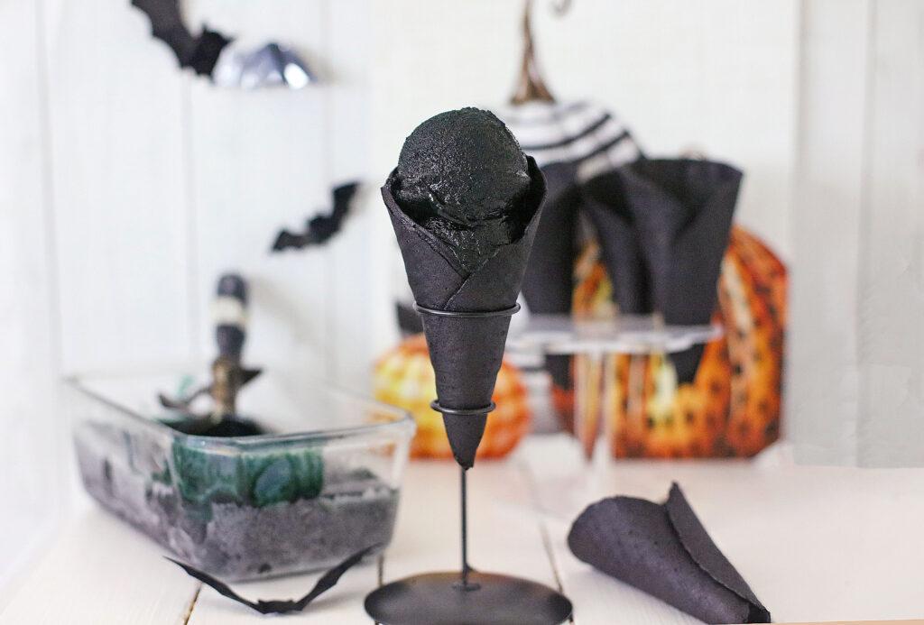 black ice cream in a black waffle cone